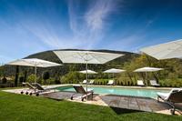 CarmineResidence Swimming pool umbrellas and sunbeds